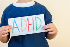 Young boy holds ADHD text Stock Photos