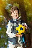 The young boy holds ball for soccer Royalty Free Stock Photos