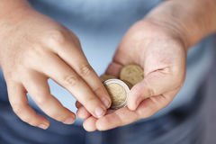 Young boy holds euro coins Stock Image