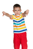 Young boy holds his thumbs down Stock Images