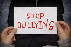 A young boy holds Stop bullying sign Royalty Free Stock Image