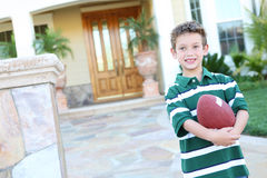 Young Boy at home with Football Stock Photos
