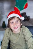 Young boy home wear red christmas santa hat Stock Photo