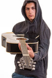 Young boy in hoodie show's you his guitar Stock Photos