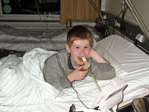 Young boy in hospital using Royalty Free Stock Photography