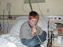 Young boy in hospital using Royalty Free Stock Photo