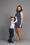 Young boy hug pregnant mother Stock Photo