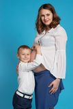 Young boy hug pregnant mother Royalty Free Stock Images