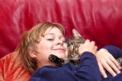 Young boy is hugging with his cat Royalty Free Stock Photo