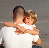 Young boy hugging his father. Portrait of a young boy hugging his father Royalty Free Stock Images