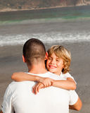 Young boy hugging his father. Portrait of a young boy hugging his father stock images