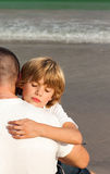 Young boy hugging his father. Portrait of a young boy hugging his father royalty free stock photo