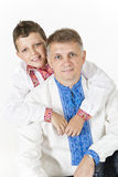 Young boy is hugging his father. Boy is hugging his father from behind isolated on white Royalty Free Stock Images