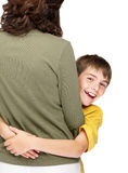 Young boy hugging his mother against white Royalty Free Stock Photo
