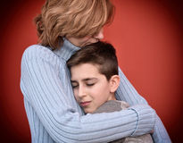 Young boy hugging his mother Royalty Free Stock Images