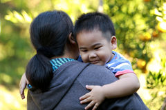 Young boy hugging his mother Royalty Free Stock Image