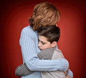Young boy hugging his mother Stock Photography