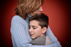 Young boy hugging his mother Stock Photo