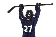 Young boy in ice hockey gear against white royalty free stock images