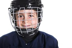 Young boy in ice hockey gear against white royalty free stock image