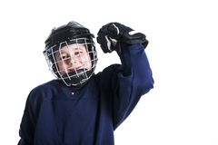 Young boy in ice hockey gear against white royalty free stock photography