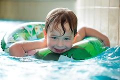Young boy in inflatable tube swimming Stock Photo