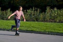 Young boy inline skating stock photos