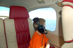 Young Boy Inside a Private Airplane Royalty Free Stock Photos