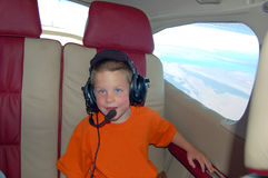 Young Boy Inside a Private Airplane Stock Photography