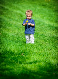 Young Boy Inspecting a Dandelion Flower Stock Image