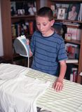 Young boy Ironing Clothing Royalty Free Stock Photography