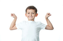 A young boy isolated over white background. Royalty Free Stock Images
