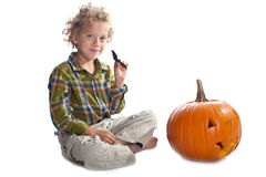 Young boy with jack-o-lantern Stock Photos