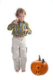 Young boy with jack-o-lantern Stock Images