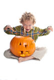 Young boy with jack-o-lantern Royalty Free Stock Image