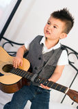 Young Boy Jamming Full Size Guitar Gritting Teeth Playing Music Stock Images
