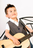 Young Boy Jamming Full Size Guitar Gritting Teeth Playing Music Royalty Free Stock Image