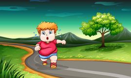 A young boy jogging. Illustration of a young boy jogging Royalty Free Stock Photos