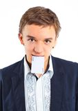 Young boy with a joker. In his hand. Isolated Royalty Free Stock Photography