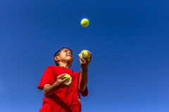 Young boy juggles balls. Stock Images