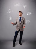 Young boy juggling with statistics and graphs. Young boy standing and juggling with statistics and graphs Stock Photos