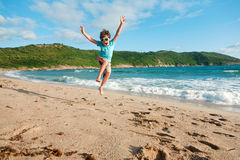 Young boy jump in the sea Stock Photos