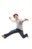 Young boy jumping. Boy jumping isolated on white background stock photography