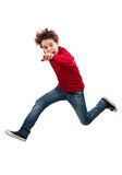 Young boy jumping. Boy jumping isolated on white background royalty free stock photos