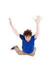 Young boy jumping. Boy jumping isolated on white background Royalty Free Stock Photo