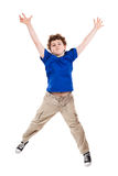 Young boy jumping. Boy jumping isolated on white background Stock Photo