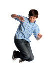 Young Boy Jumping. Portrait of young boy jumping isolated over white background Stock Images