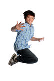 Young Boy Jumping. Isolated over white background Stock Images