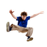 Young boy jumping. Boy jumping isolated on white background Royalty Free Stock Photography