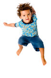 Young Boy Jumping. A cute young boy jumping in the air on white background stock image